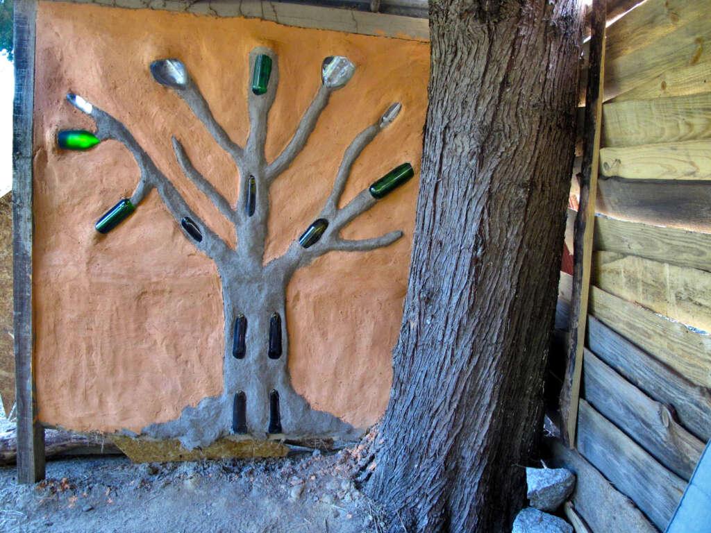 Cob wall tree sculpture